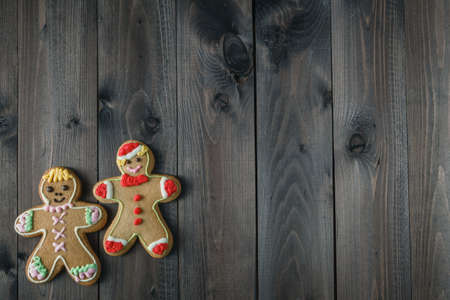 gingerbread man: Two cookies gingerbread man on aged wooden table