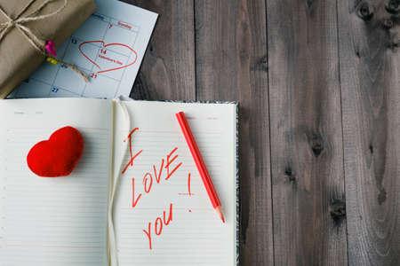 love message: Love message on grunge wooden table. Dark night shot