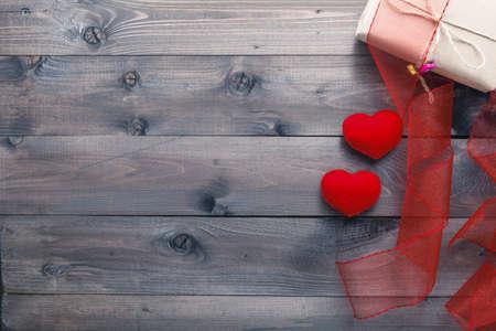 nylon: love background on rustic wood. red nylon ribbon