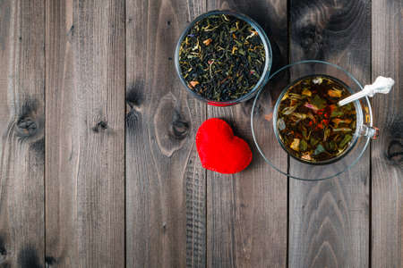 cooky: Hot herbal tea on dark aged wooden background