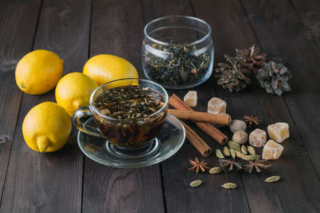 home accents: Relaxing herbal tea on rustic wooden table. Evening at home