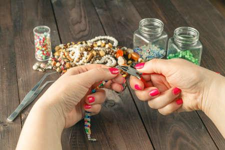 wooden handmade: Relax home hobby. Woman make handmade beads