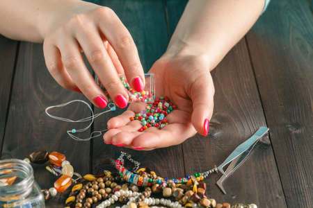 seed beads: beads, scissors, and tools for creating fashion jewelry in the manufacturing process