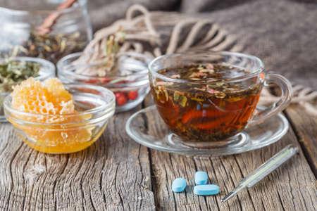 berryes: Folk alternative medicine concept. Herbal honey tea woth berryes