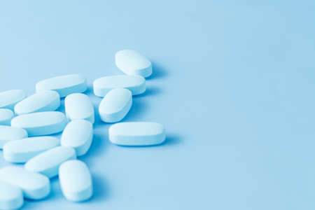 painkiller: Blue medicine painkiller on blue background