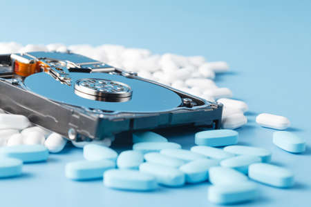 computer devices: Antivirus drugs and hard drisk. Information cure concept Stock Photo