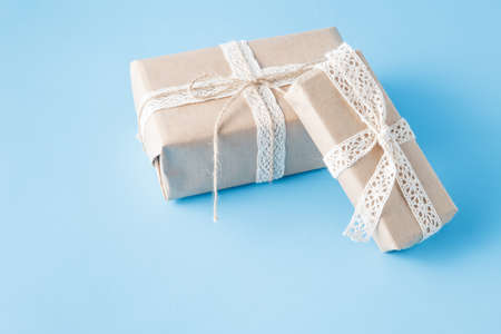 hand crafted: hand crafted present box on blue background