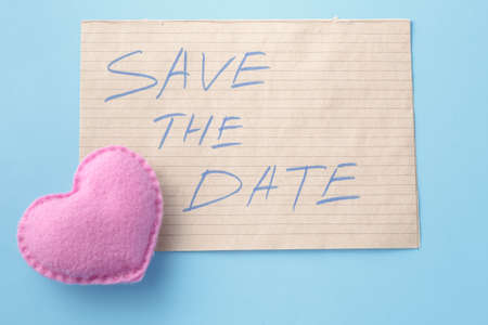 earthy: Announce invitation card. Soft toy heart and message save the date. Stock Photo