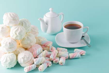 caffee: Morning caffee background. Lot of vibrant marshmallow on aquamarine background