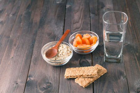 energy bar: Energy bar with water glass and dry apricot