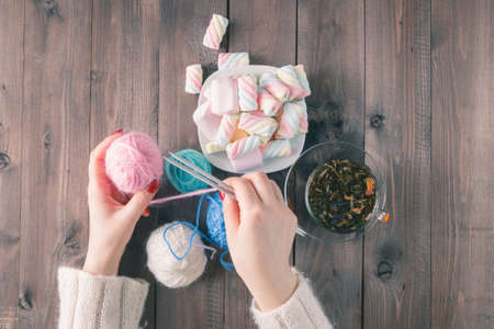 make a gift: Handmade gift for special day as mother day, father day, valentine day or wintertime, heap of ball of wool to knit colorful scarf for cold day, knitting to make meaningful present