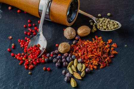 pepper grinder: Spice and pepper grinder on slatr background