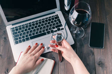 working woman: woman working on laptop and drinking wine Stock Photo