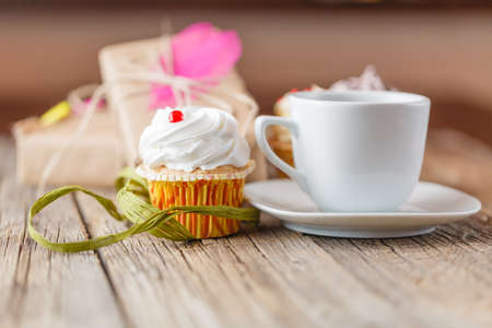 butter icing: cupcake and cup of coffee Stock Photo