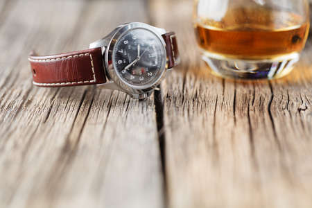 Whiskey glass with watch