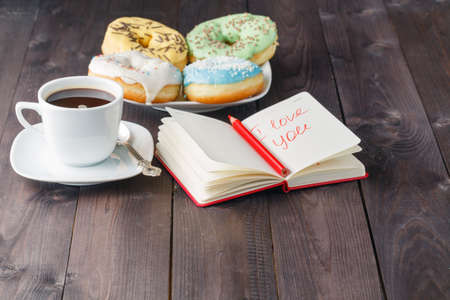 love icon: Donuts and i love message in notebook Stock Photo