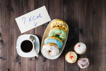 How much calories in sweet donuts, woman hold note with question