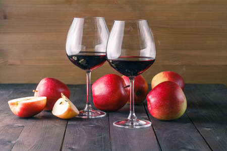 sommeliers: Couple of red wine glass on wooden table
