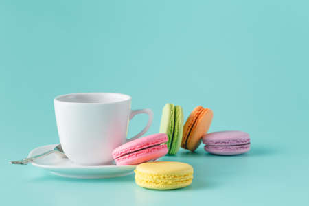 Cup of coffee and french macaroon