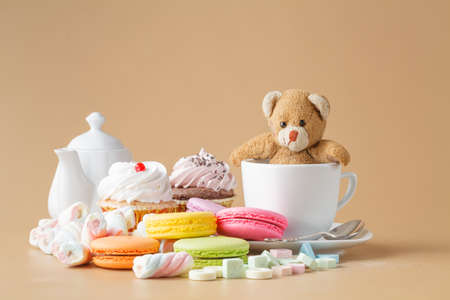 colorfu: Set of colourful macaroons with toy bear. Kid morning breakfast Stock Photo