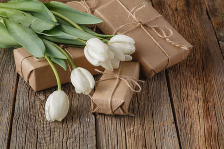 hand crafted: Hand crafted box present with tulips flowers Stock Photo