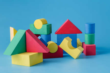 photo of object s: The toy castle from color blocks on  blue background