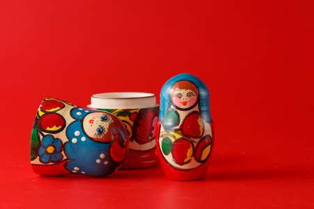 matreshka: Russian traditional matreshka on red background