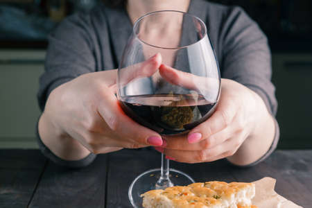 musing: adult woman and a glass of wine