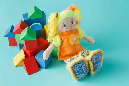 bilding: Baby play  concept, cloth doll and wooden bilding blocks for play Stock Photo