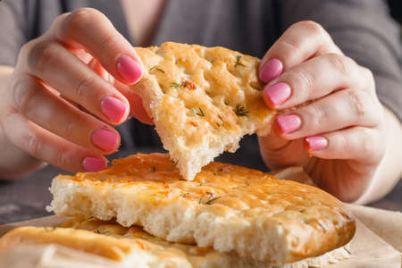 starving: Piece of bread in woman hands