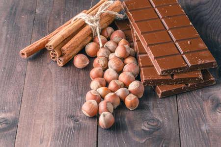 wicker bar: chocolate with ingredients on dark wooden background