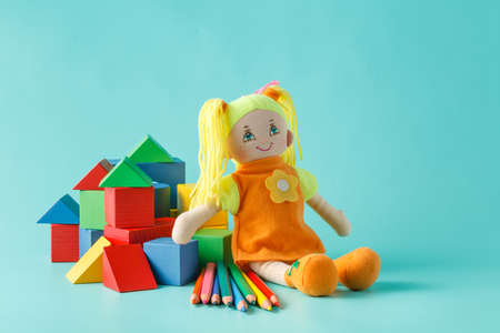 artists dummy: Creative kid play concept. Doll with colored pencils