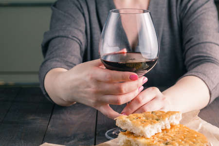 women's hands: womens hands and a glass of wine Stock Photo