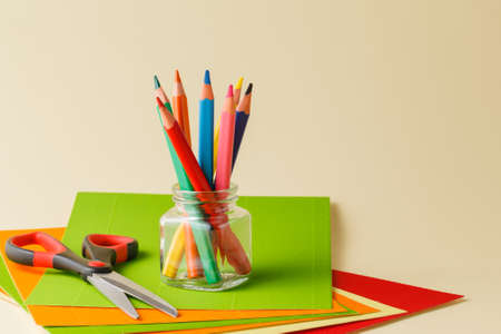 color pencil: Various school and art supplies laid on table Stock Photo