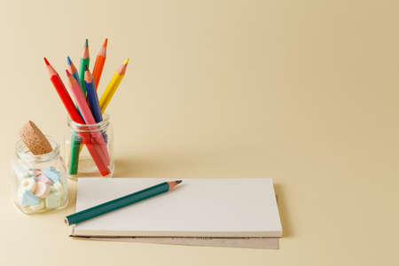 portrait orientation: Homework workplace with color pencil an mpti notepad Stock Photo