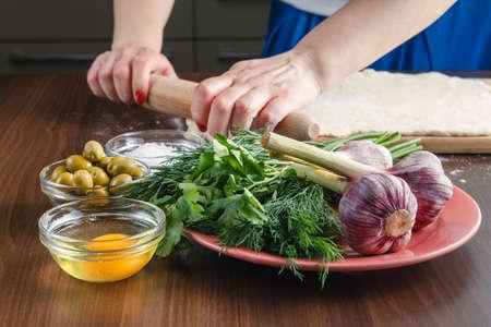 ciabatta: Making ciabatta bread with garlic, mediterranean olives