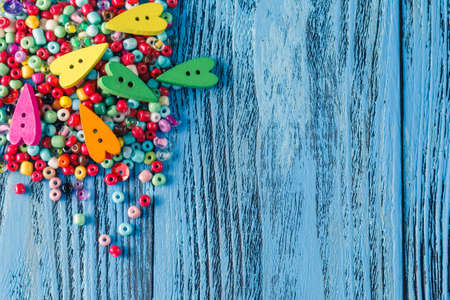 colorful beads: different colorful beads on the wooden table