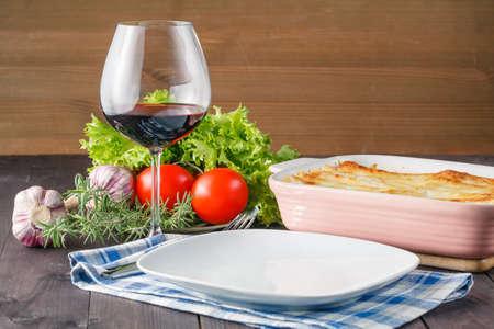 prepared: Fresh prepared lasagne with ingredients on table