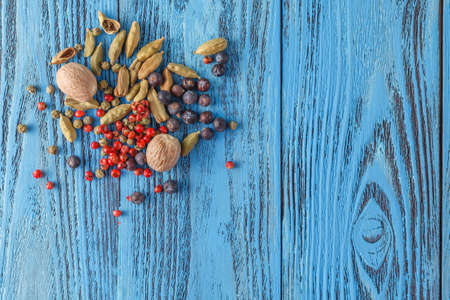kulinarne: culinary background with spices on wooden table