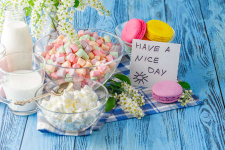 frence: Glass of milk with Tasty macaroon on with background and message have a nice day Stock Photo