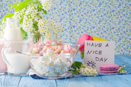 frence: Glass of milk with Tasty macaroon and message have a nice day