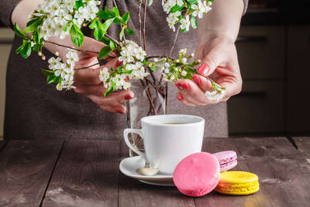 dearness: Spring breakfast concept. Macaroon and coffee on table with cherry flowers Stock Photo