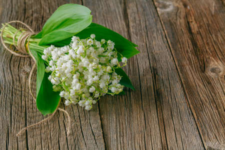 lily of the valley on wood rustic background