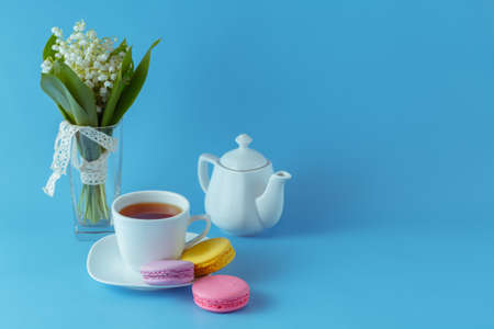 flavorsome: Seasonal breakfast with macaroons on blue background Stock Photo