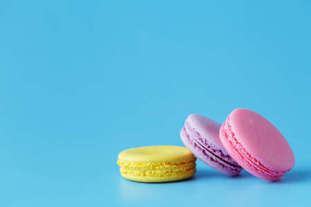 room for copy: macarons over blue background with room for copy space