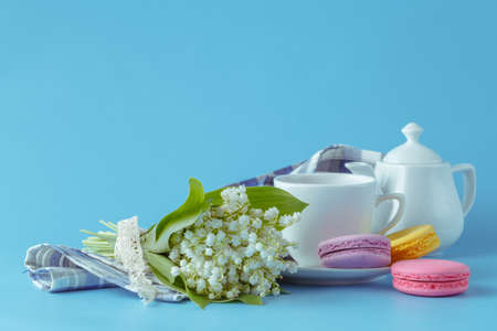 Spring tea drinking with white flowers  on blue background Stock Photo