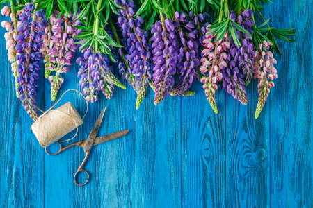 lupines: Lupines Flowers on wooden background Stock Photo