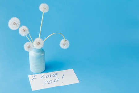 Summer dandelions and paper with words I love you