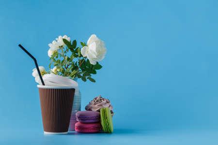 mug of coffee: Colorful macaroons and coffee cup