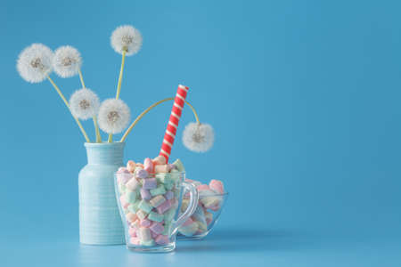 rubbery: Sweet candies on blue color table Stock Photo